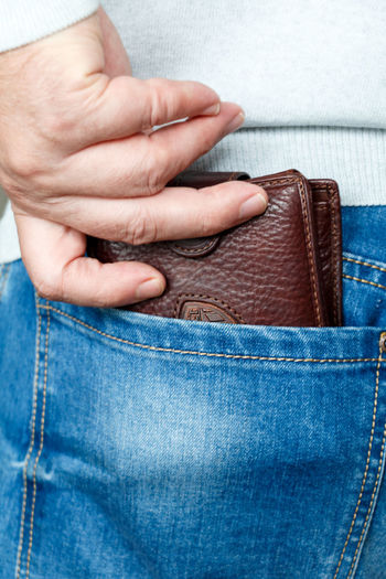 Human Hand Jeans Blue Human Body Part Denim Human Finger One Person Lifestyles Adults Only One Man Only Only Men Finance Money Wallet Pouch Pocket  Cash Costs Expenses Men Budget Capital Wealth Coins Payment