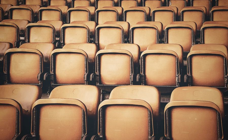 - CHOOSE ONE - Check This Out Yellow Yellow Plastic Seats In A Row Backgrounds Full Frame Seat Side By Side Chair Repetition Large Group Of Objects Arrangement Order Indoors  No People Auditorium Abundance Empty Pattern Close-up High Angle View Visual Creativity
