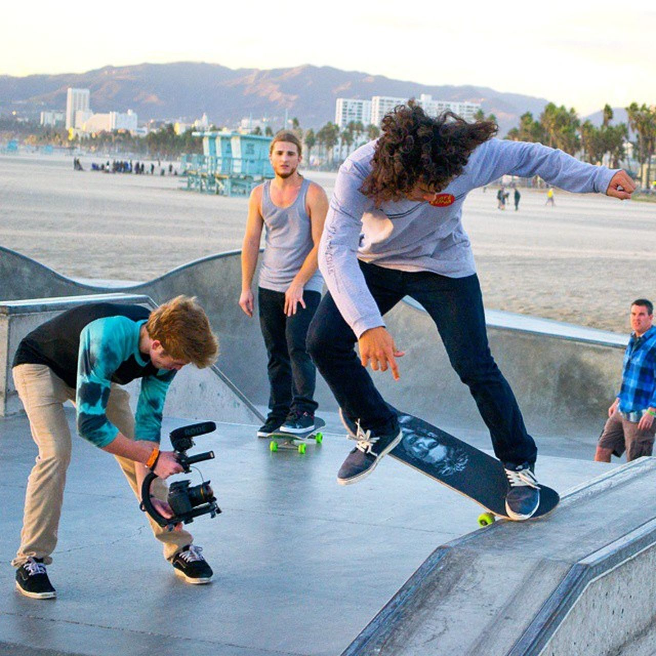 full length, skateboard, three people, leisure activity, togetherness, sport, adult, day, lifestyles, skateboard park, people, motion, friendship, young adult, skill, healthy lifestyle, outdoors, young women, men, adults only, city
