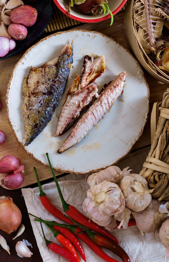 High angle view of fried mackerels in plate on table