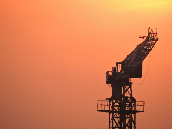 Contruction Work Site Construction Site Seeing Sunset Sky Sunset Architecture Orange Color Nature No People Copy Space Clear Sky Industry Building Exterior Built Structure Outdoors