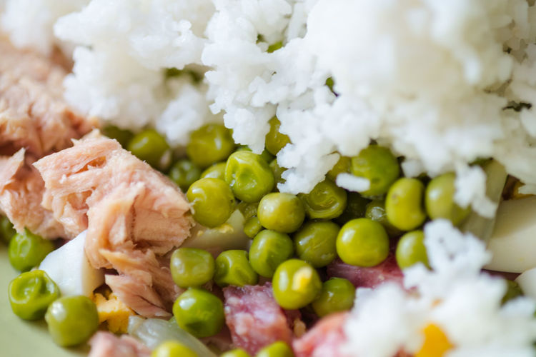 Close-up of cooked peas and rice with meat
