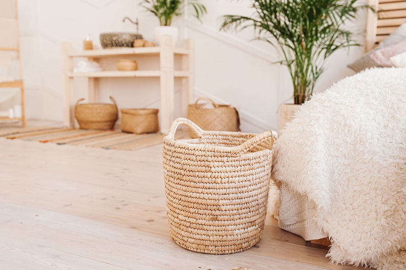 Light interior made of natural eco components. wicker straw basket for clothes