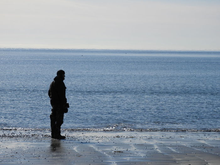 One Man On Beach Silouette Beach Sandy Beach Ocean Horizon Over Water Blue Nature Photography Nature Beauty In Nature Peaceful Calm Winter In New England Winter Water Full Length Sea Beach Standing Sky Horizon Over Water Scenics Cold Temperature Coast Shore Low Tide Tranquil Scene Coastline Cold