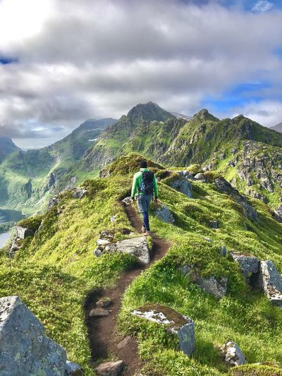 Mountain Sky Beauty In Nature Hiking Nature Real People Rear View Scenics Cloud - Sky Day Men One Person Adventure Walking Full Length Backpack Outdoors Lifestyles Lofoten