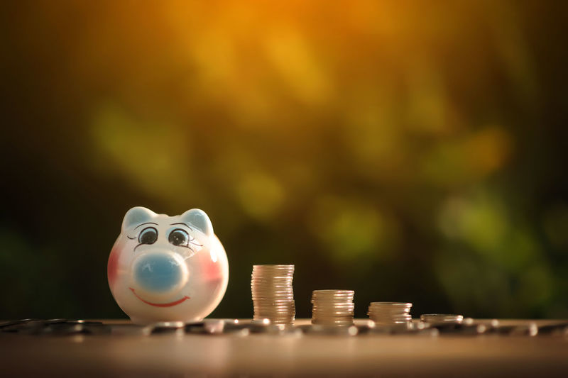 Piggy bank and coins on table