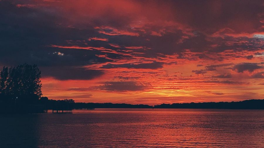 Sunset Beauty In Nature Nature Scenics Silhouette Tranquil Scene Water Sky Tranquility No People Sea Outdoors Tree Day