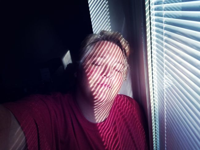 Woman darkness and light Lgbt Lesbian Adult Shadows & Lights Portrait Self Portrait Women Red Human Face Looking Through Window Window Depression - Sadness Blinds Loneliness Solitude