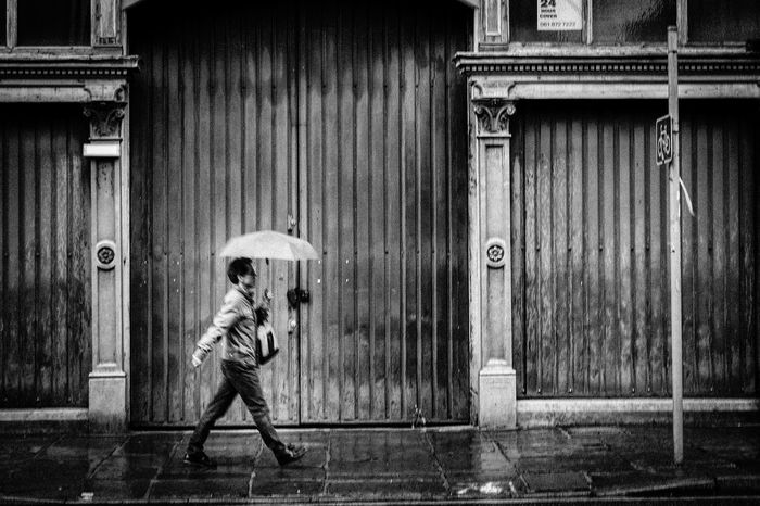 Raining day🌧 Rainy Days Rain Umbrella Man Walking Streetphotography Streetphoto_bw City Life Fine Art Photography Opposite On The Other Side Sidewalk Blackandwhite Black & White Blackandwhite Photography Showcase July The Street Photographer - 2017 EyeEm Awards