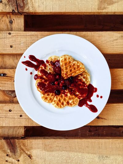 High Angle View Of Waffle Served In Plate On Wooden Table