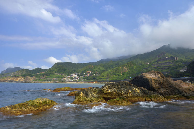 The northeast corner of Taiwan's New Taipei City is a scenic spot suitable for sightseeing. Jinguashih Taiwan Beach Beauty In Nature Cloud - Sky Day Environment Land Motion Mountain Nature New Taipei City No People Northeast Coast National Scenic Area Outdoors Rock Rock - Object Ruifang Scenics - Nature Sea Sky Solid Tranquil Scene Tranquility Water