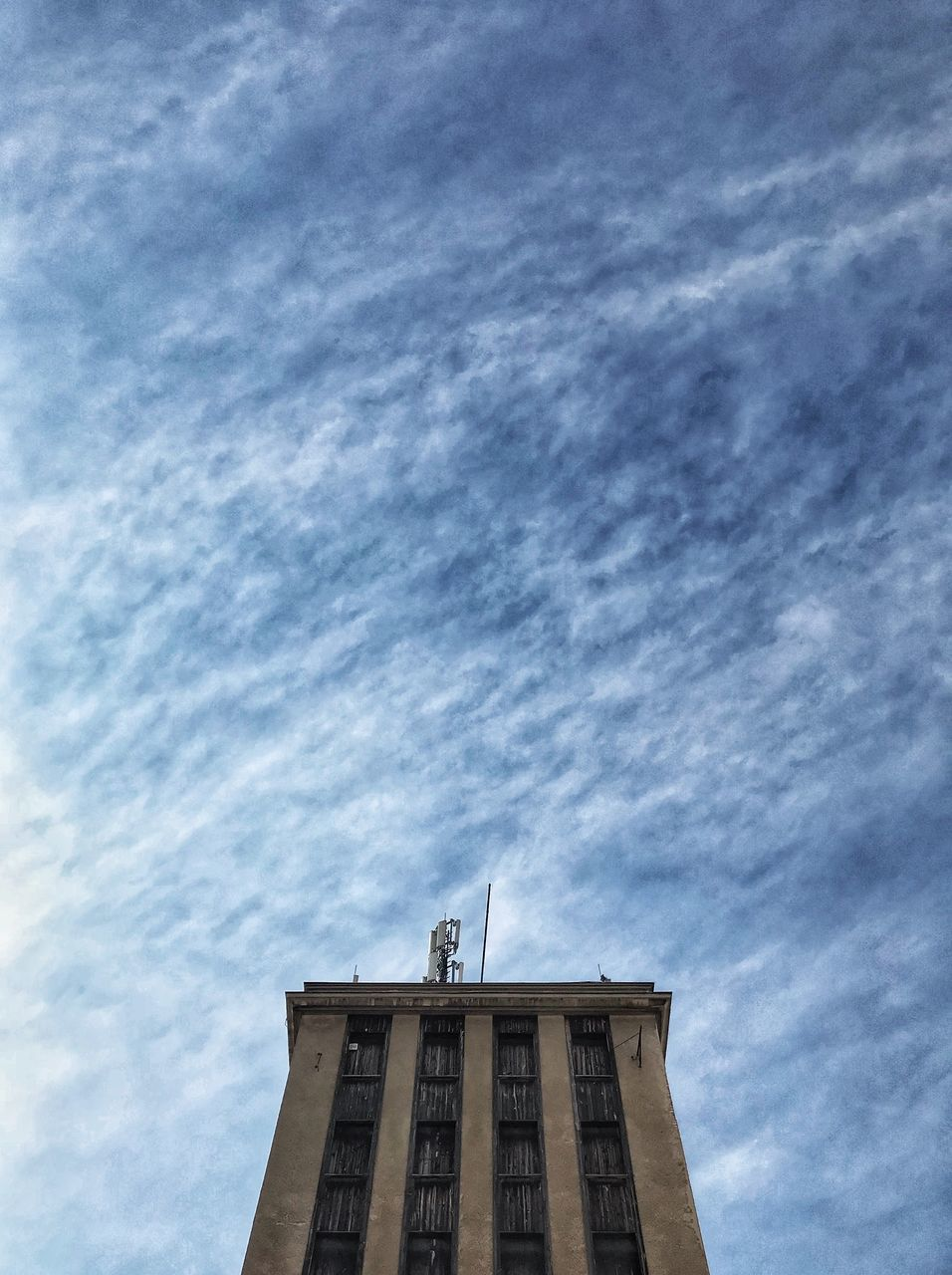 HIGH SECTION OF HISTORIC BUILDING AGAINST SKY