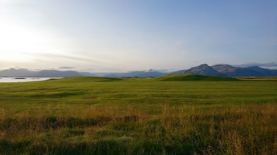 That would fit very well your desktop wallpaper. Field Iceland Stunning Sublime Travel Travel Photography Traveling Beauty In Nature Cloud - Sky Grass Green Color Horizon Over Land Infinity Landscape Mountain Nature No People Scenics Sunset Tranquil Scene Travel Destinations Wallpaper Wallpapers Wide Wide Shot