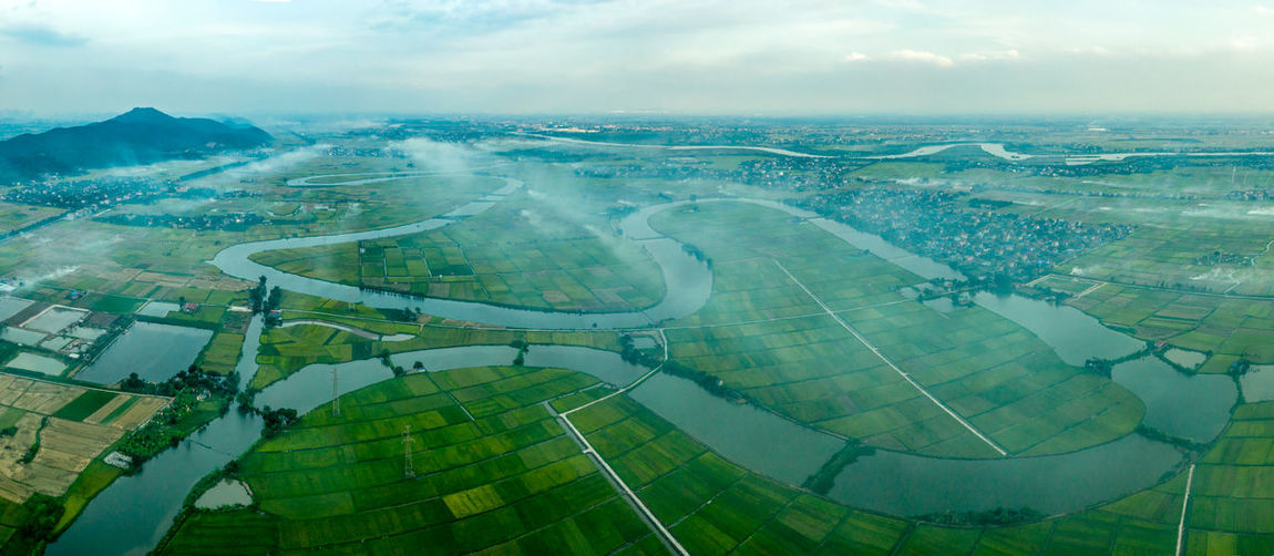 River Environment Aerial View Landscape Nature Cloud - Sky Sky Day Scenics - Nature Agriculture Beauty In Nature Patchwork Landscape No People Tranquil Scene Outdoors Tranquility Field Land Water Rural Scene City