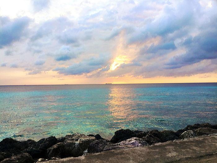 Sundown on the island of Curaçao Beach Beauty In Nature Cloud - Sky Horizon Horizon Over Water Idyllic Land Nature No People Non-urban Scene Outdoors Rock Scenics - Nature Sea Sky Solid Sunset Tranquil Scene Tranquility Water