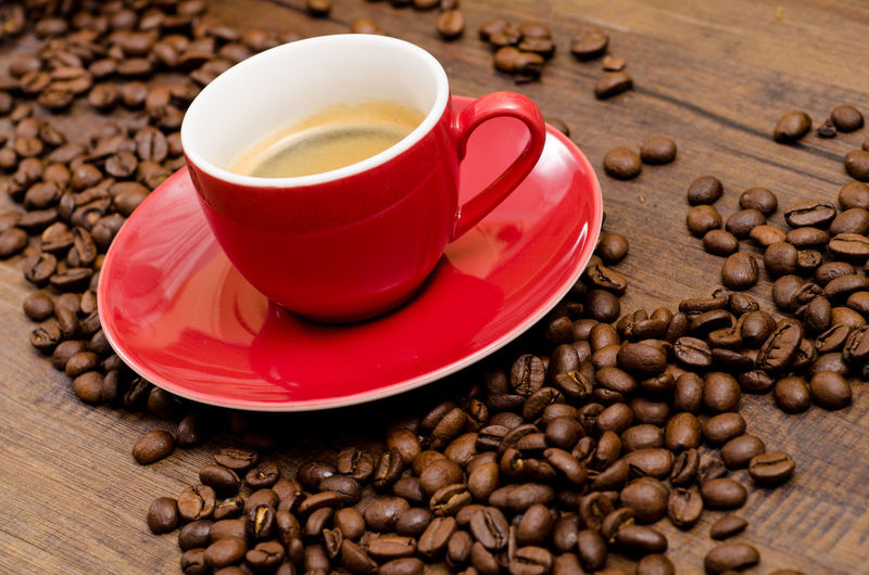 Red cup espresso coffee with beans Espresso Brown Cafe Cappuccino Close-up Coffee - Drink Coffee Beans Coffee Cup Cup Drink Espresso Food And Drink Freshness Frothy Drink Indoors  Latte Mocha No People Raw Coffee Bean Red Refreshment Roasted Roasted Coffee Bean Saucer Scented
