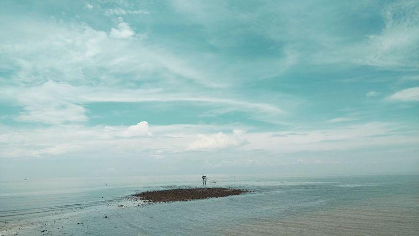 天空之下 Sea Horizon Over Water No People Beach Cloud - Sky Tranquility Outdoors Nature Day Water Blue Beauty In Nature Sky Scenics Bird Lighthouse Animal Themes Nautical Vessel