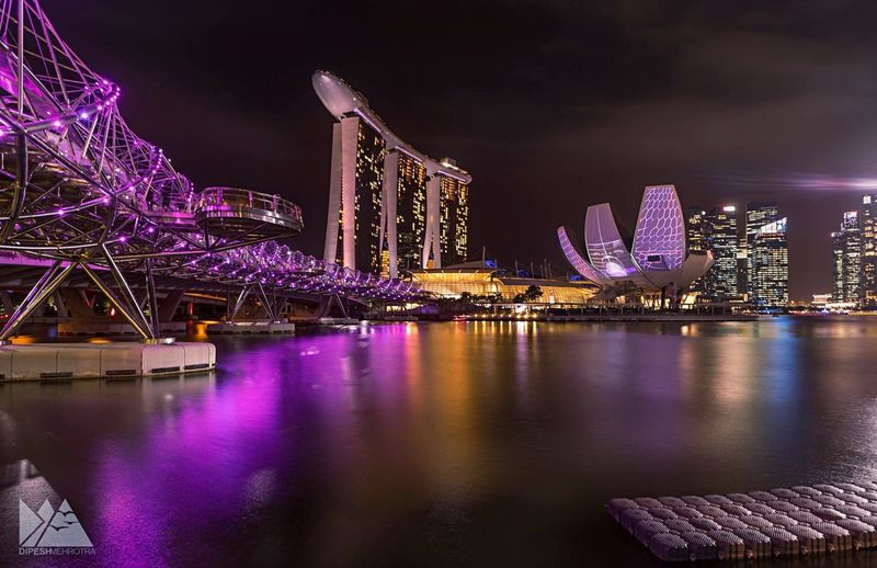 Long exposure.. my few nights in Singapore Night Illuminated Architecture Building Exterior City Arts Culture And Entertainment Travel Destinations Cityscape Outdoors Built Structure Skyscraper Celebration Ferris Wheel Sky Urban Skyline No People EyeEm EyeEmNewHere Sonyalpha SONY A7ii Break The Mold