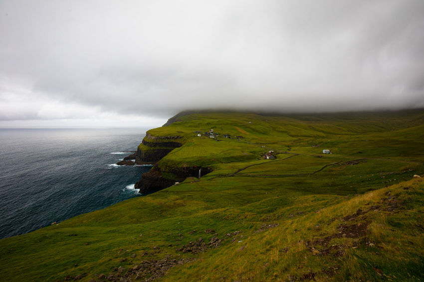 Gasadalur Scandinavia Tadaa Community Beauty In Nature Cliff Cloud - Sky Day Environment Faroe Islands Grass Horizon Horizon Over Water Land Landscape Nature No People Outdoors Overcast Plant Scenics - Nature Sea Sky Tranquil Scene Tranquility Water