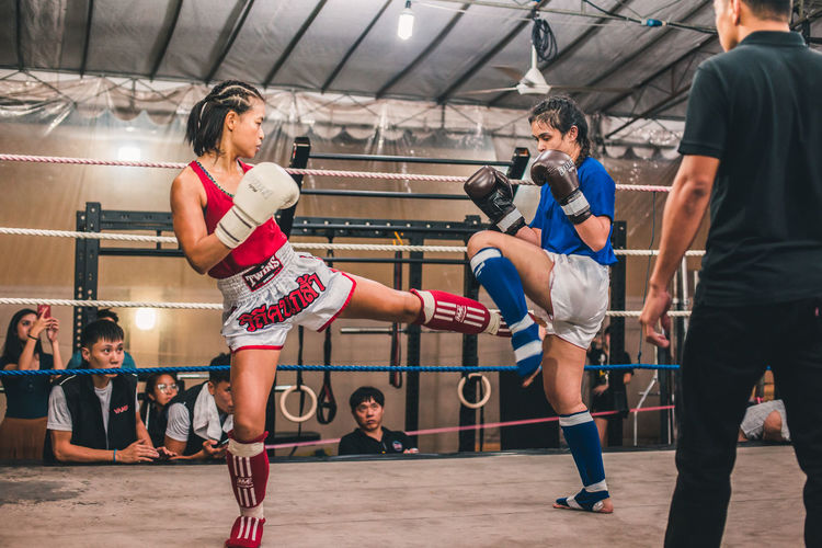 One for one. International Women's Day 2019 Sport Real People Vitality Boxing - Sport Women Healthy Lifestyle Lifestyles Exercising Sports Clothing Sports Training Athlete Determination Competition Effort Strength Young Woman Sportswoman Muay Thai Fight Kickboxing