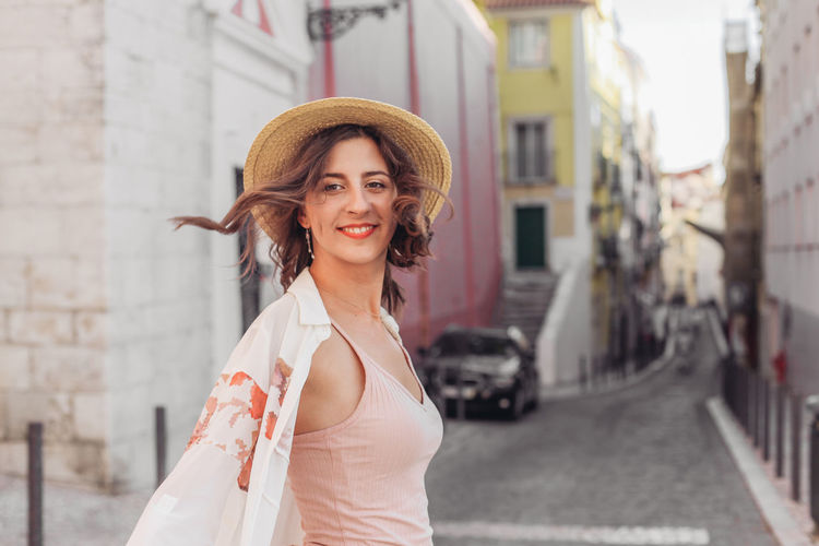 Portrait of smiling young woman in city