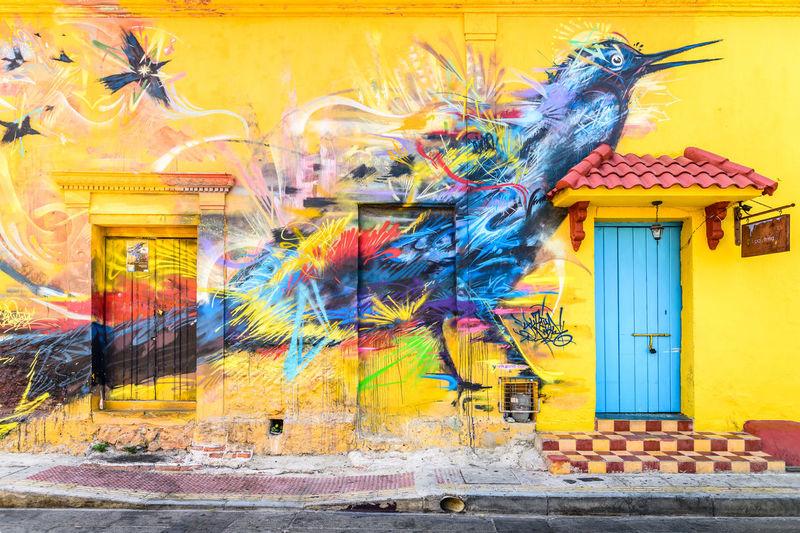 Bird of Cartagena Cartagena Colombia Colors Colour Your Horizn Doors Fly Graffiti Animal Themes Architecture Bird Building Exterior Built Structure Cartoon City Day Door Graffiti & Streetart Graffiti Art Graffiti Wall Lifestyles No People Outdoors Streetphotography Yellow