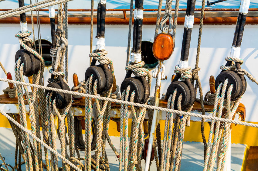 Abundance Close-up Day Detail Deterioration In A Row Metallic Nautical Vessel No People Outdoors Pulley Pulleys Ropes Sail Boat Sails Ship Side By Side Sky Wooden Wooden Post