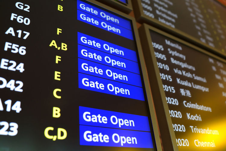 Airport arrival depature board close up Text Western Script Arrival Departure Board Communication Number No People Airport Transportation Business Information Technology Travel Close-up Indoors  Illuminated Backgrounds Full Frame Sign Information Sign Multi Colored Airport Terminal Gate Opening