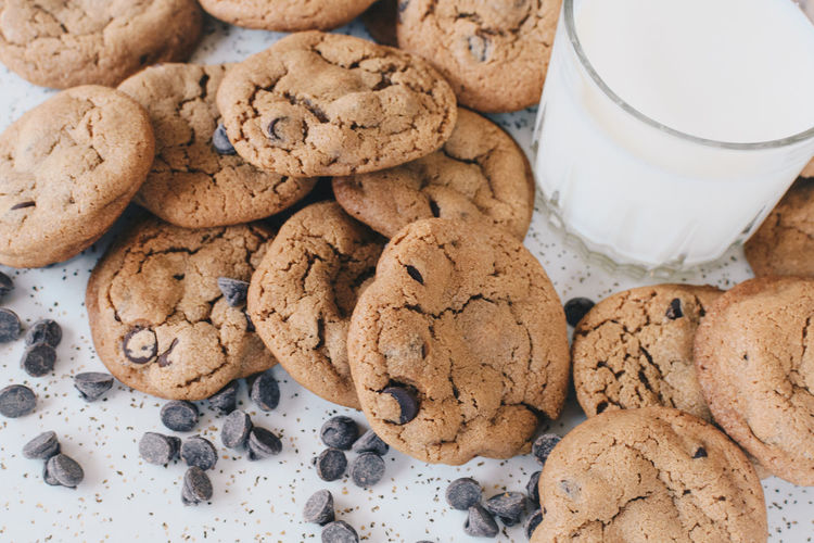 Close-up of cookies by milk glass