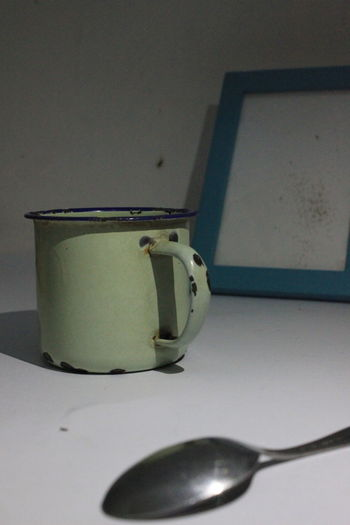 Close-up of empty tea cup on table