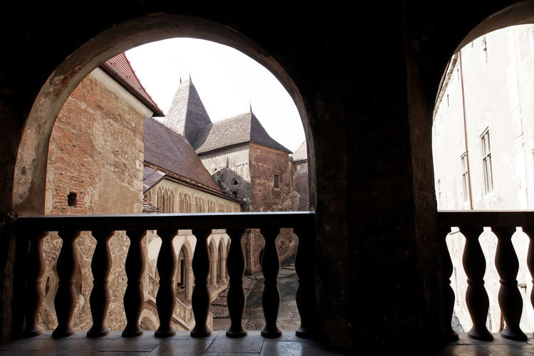 Panoramic view of old historic building seen through window