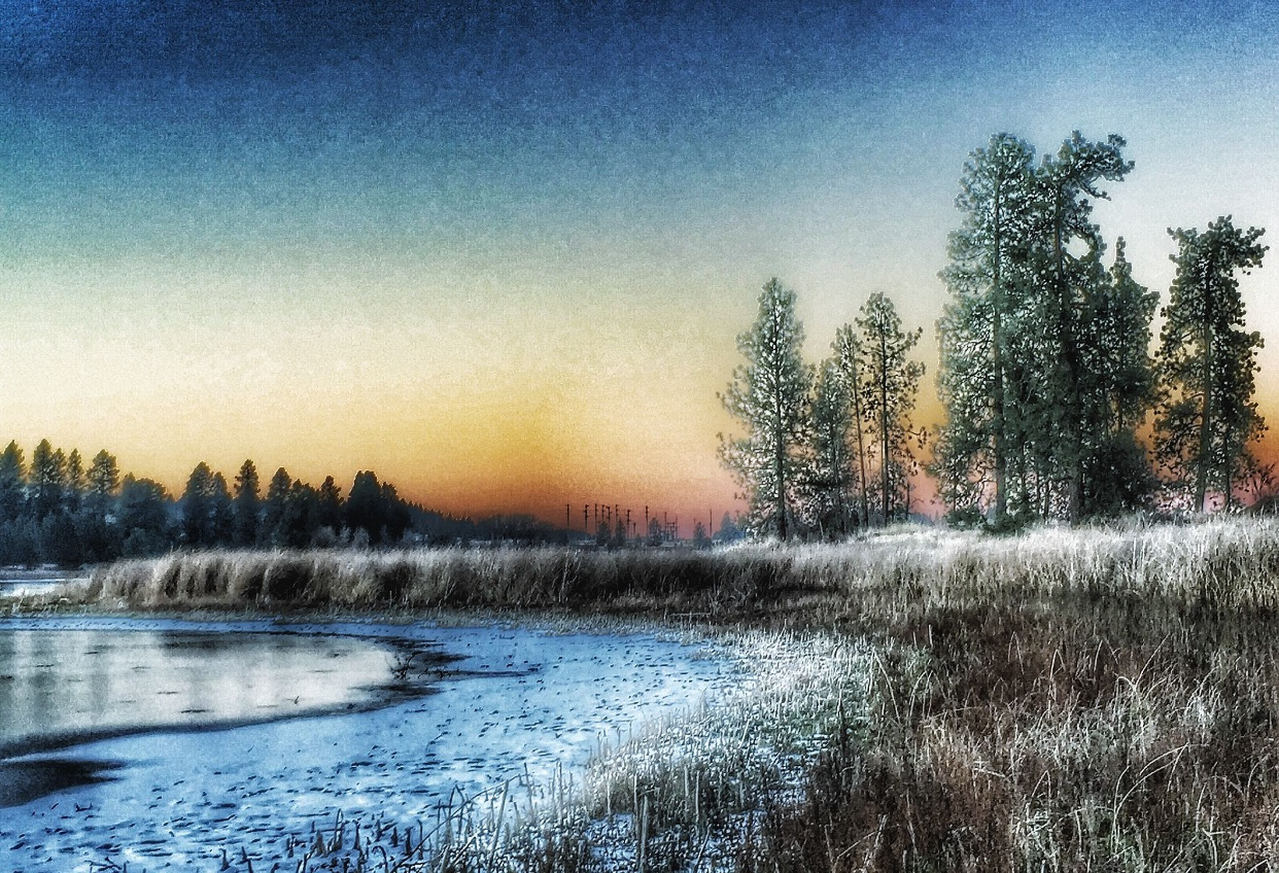 winter, cold temperature, snow, sunset, tranquil scene, tree, scenics, tranquility, beauty in nature, water, season, nature, clear sky, weather, frozen, sky, silhouette, bare tree, landscape, lake