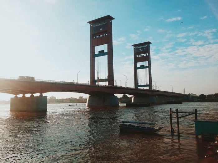 Bridge Over Calm Lake Against The Sky