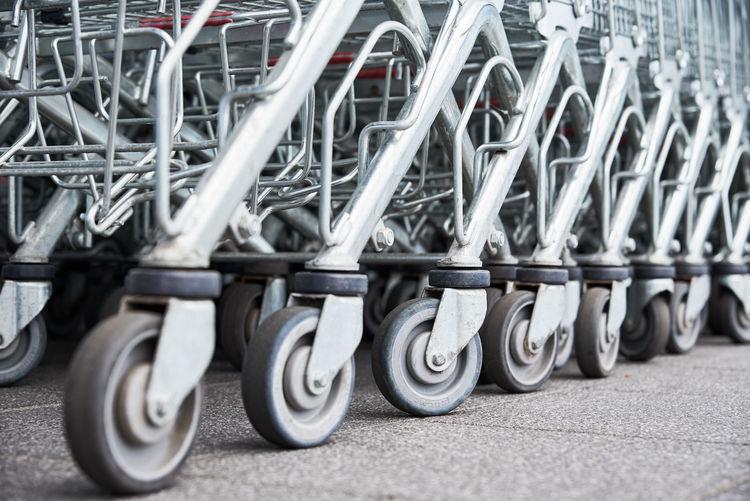 Row of shopping cart on floor