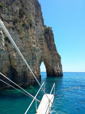 Arch Natural Arch Blue Water Day Outdoors Sky No People Zakynthos,Greece Zakynthos Boat Trip Exploring Greece Sea Vacations Summer Travel Destinations Tranquility Seascape Ocean Boat Sailing Tourism Rock Formation Sailing Boat
