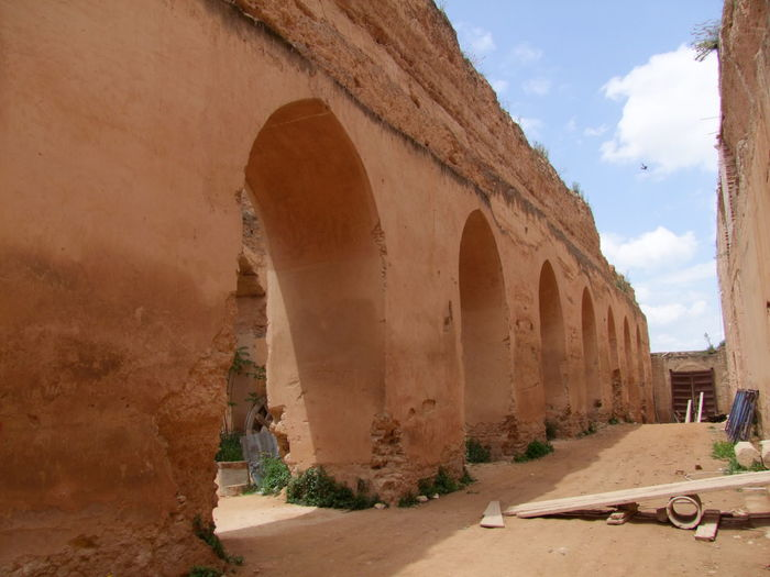 Thick Wall Construction of Royal Stables built by Moulay Ismael Ancient Civilization Arches Architecture Blue Sky White Clouds Built Structure Composition Famous Place Full Frame Historical Building Historical Place History Meknès Meknès City Moroccan Architecture Moroccan Style Morocco Moulay Ismail No People Outdoor Photography Royal Stables Stables Sunlight And Shadows Thick Walls Tourist Attraction  Tourist Destination
