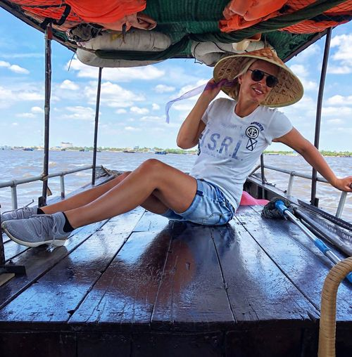 Woman sitting in boat on river