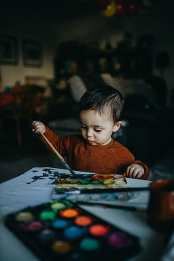 Portrait of boy playing at table