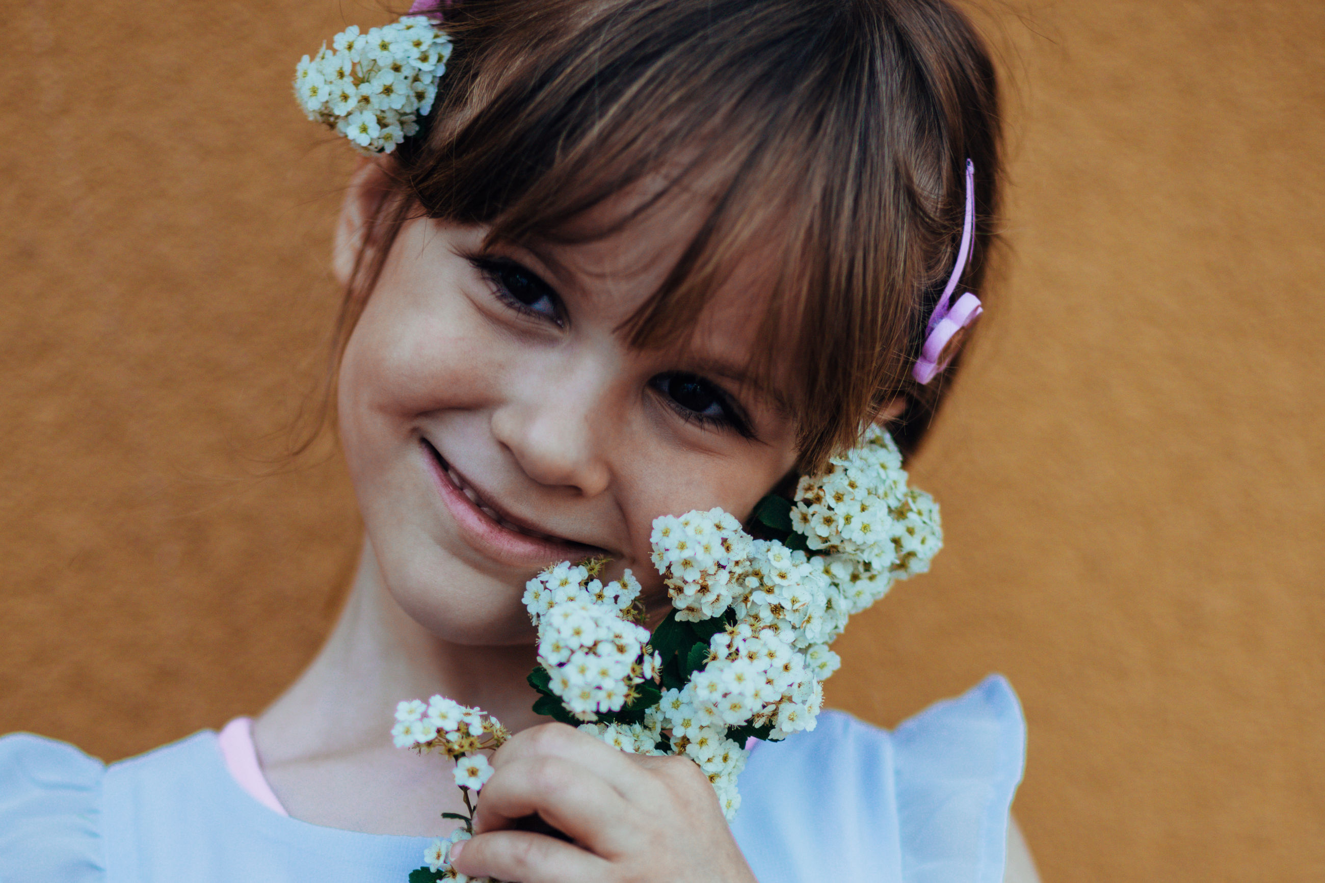 one person, portrait, looking at camera, childhood, smiling, flower, close-up, real people, holding, children only, girls, headshot, happiness, indoors, one girl only, freshness, food, child, day, people
