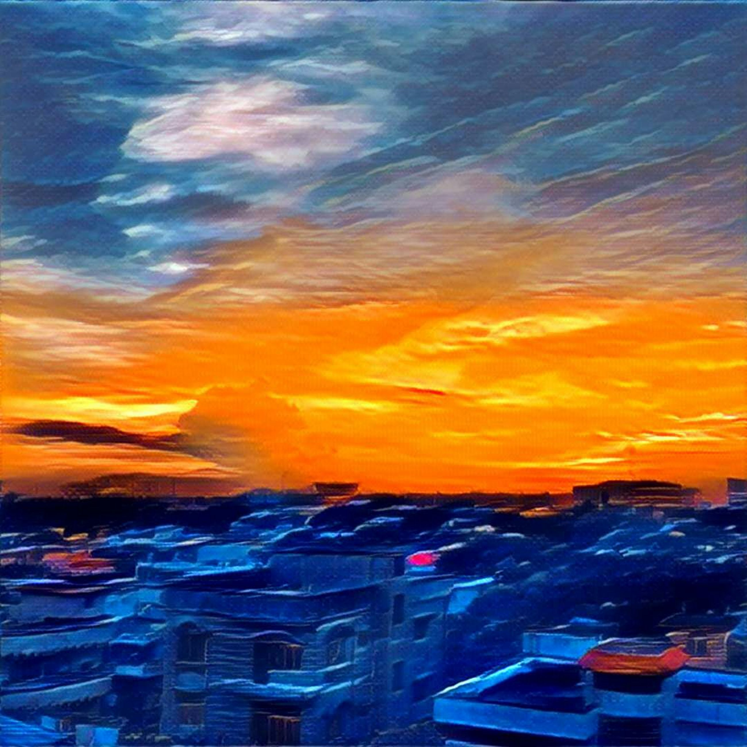 sunset, cloud, multi colored, orange color, city, cloud - sky, scenics, dramatic sky, sea, sky, vibrant color, blue, romantic sky, nature, outdoors, aerial view, moody sky, no people, cloudscape, colorful, city life, beauty in nature, atmosphere, tranquility, tranquil scene