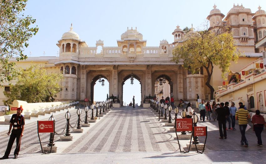 Entrance to the Grand City Palace, Udaipur Adult Architecture Building Exterior Built Structure City Clear Sky Crowd Day History Large Group Of People Lifestyles Men Mixed Age Range Nature Outdoors People Real People Sky Travel Destinations Tree Women