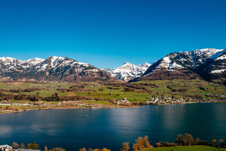 Beauty In Nature Blue Clear Sky Copy Space Countryside Day Idyllic Lake Landscape Majestic Mountain Mountain Range Nature Non-urban Scene Obwalden Reflection S Sarnen Scenics Snowcapped Mountain Tranquil Scene Tranquility Water