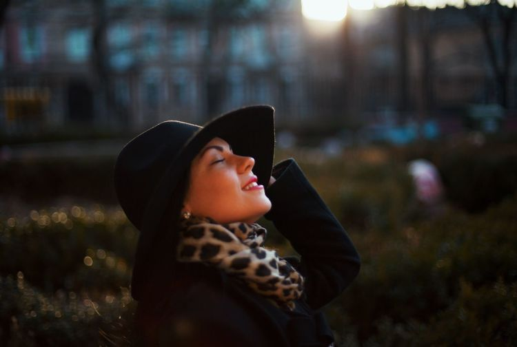 Close-up of young woman with closed eyes standing at park