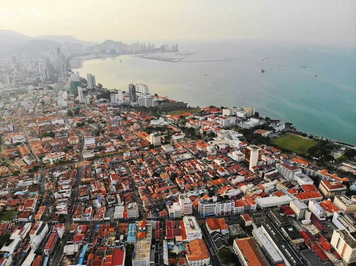 Aerial view of georgetown city, penang Aerial Ocean Aerial View High Angle View Drone  Business Finance And Industry Penang Malaysia ASIA Landscape Georgetown EyeEm Best Shots EyeEm Selects Eyeemphotography Urban City Cityscape Water Sea Beach Sunset Sky Horizon Over Water Seascape Coastal Feature Rugged Skyline Urban Scene Skyscraper Crowded