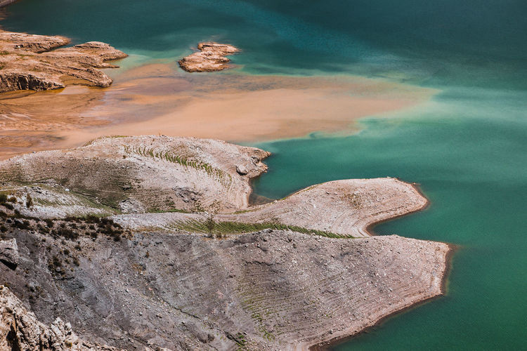 High angle view of rocks in water against sky