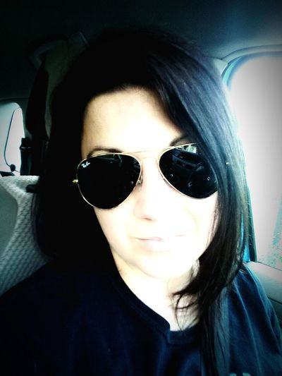 buongiorno... Portrait Young Women Looking At Camera Headshot Car Interior Sunglasses