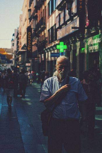Streetphotography Old Man Street Photography Madrid Shadows & Lights City Architecture Building Exterior Built Structure Street City Life Men One Person Lifestyles Casual Clothing City Street Standing Walking Capture Tomorrow My Best Photo Streetwise Photography The Art Of Street Photography