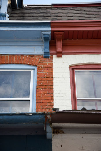 Split. Architecture Built Structure Window Building Exterior Low Angle View Brick Wall Day Red Outdoors Exterior No People Blue Split 50/50 Contrast Takeover Contrast Variation Taste Different Interesting EyeEm Best Shots Streetphotography Town