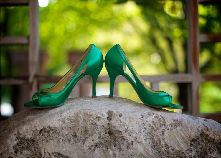 Green high heels on rock