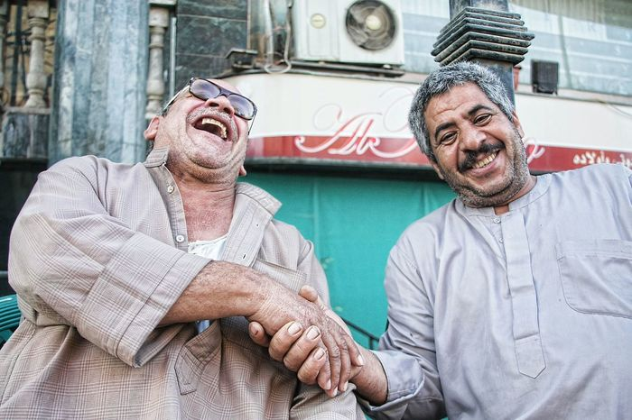 Two old friends shares a joke. The Street Photographer - 2014 EyeEm Awards Laugh Friendsforlife